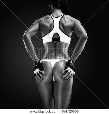 Back Of A Fit And Muscular Woman Athlete In Sports Bra