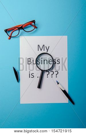 Business Word With Business Document Paper On Blue Background