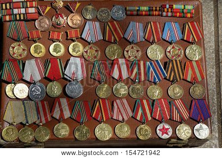 Veteran medals for their labour scattered on a table