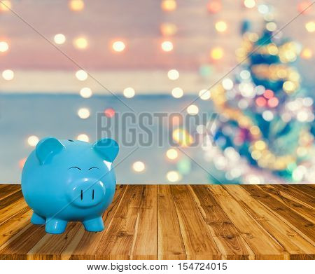Blue Pig Bank On Wood Plank With Sparkle Blur Christmas Tree. You Can Apply For Blur Christmas Wallp