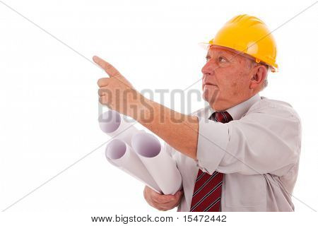 Experienced engineer holding some blueprints and pointing to the copy space  (isolated on white)