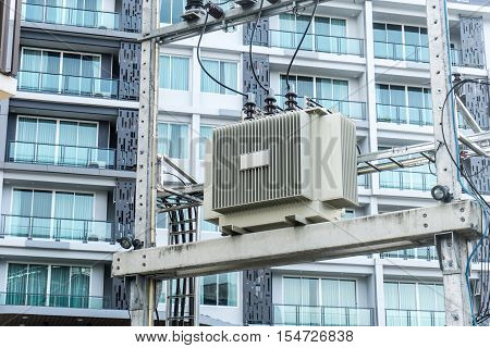 High Voltage Transformers Energy and technology electrical post by the road with power line cables