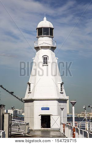 YOKOHAMA, JAPAN - OCTOBER 6, 2016: Yokohama South Inner Breakwater Lighthouse in Japan. It was built in 1896 and is inactive since 1958.