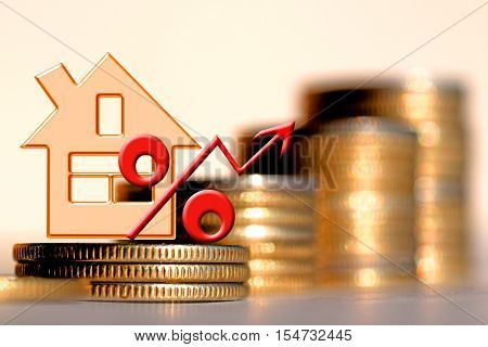 Red percent sign on a background of money . The concept of price changes on the real estate market .
