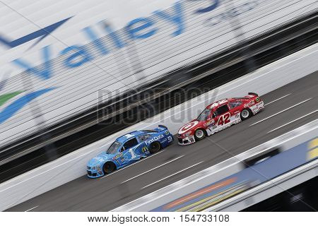 Martinsville, VA - Oct 30, 2016: Kyle Larson (42) battles for position during the Goody's Fast Relief 500 at the Martinsville Speedway in Martinsville, VA.