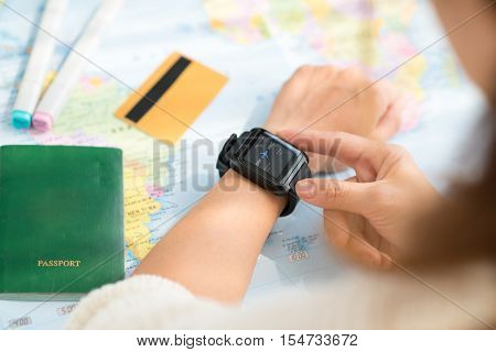 Woman checking flight timetable on her smart watch