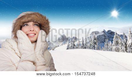 Beautiful winter portrait of young brunette woman in the winter snowy scenery