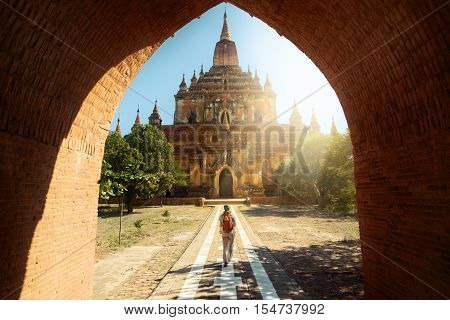 Traveler walking along the road to the Htilominlo temple in Bagan Myanmar