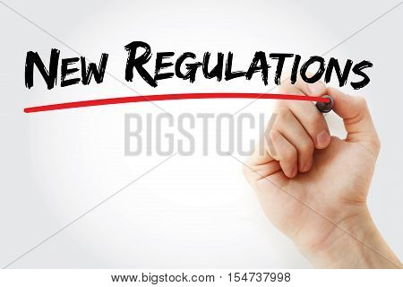 Hand Writing New Regulations With Marker