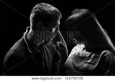 Monochrome studio portrait of a passionate couple