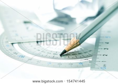 selective focus of the pencil with precision measurement tool