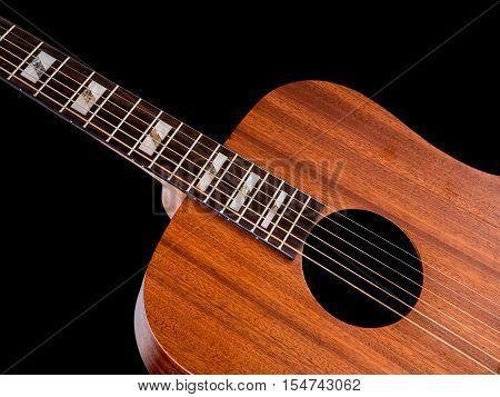 Closeup shot of acoustic guitar bridge and inlay