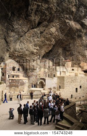 TRABZON, TURKEY - MAY 26: Tourists visit Sumela Monastery on May 26, 2011 in Trabzon,Turkey. Sumela is 1600 year old ancient Orthodox monastery.