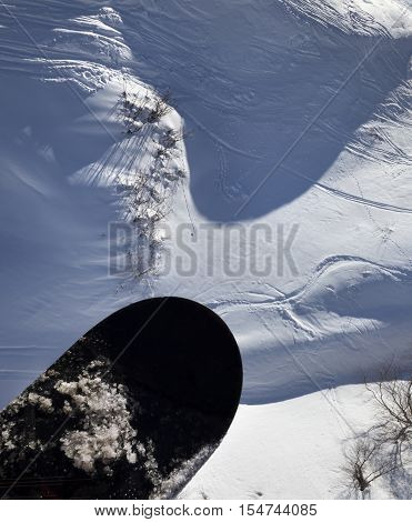 View From Chair-lift On Snowboard Over Off-piste Slope