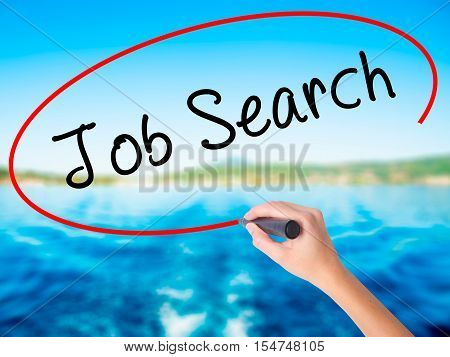 Woman Hand Writing Job Search With A Marker Over Transparent Board