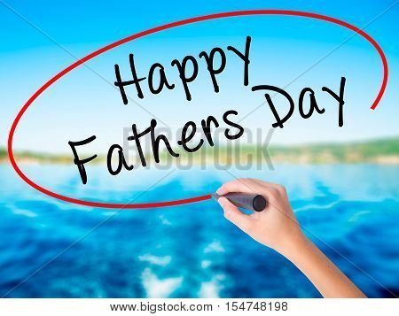 Woman Hand Writing Happy Fathers Day With A Marker Over Transparent Board