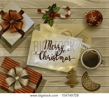 Christmas New Year design wooden background with christmas decorations candy canes with gift boxes and envelope handwritten Merry Christmas cup of coffee and gingerbread cookies. in old photo style grange