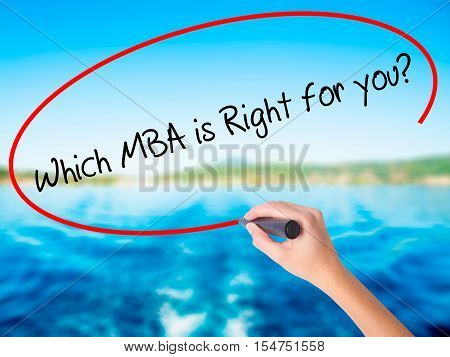 Woman Hand Writing Which Mba Is Right For You? With A Marker Over Transparent Board