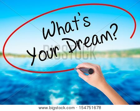 Woman Hand Writing What's Your Dream? With A Marker Over Transparent Board
