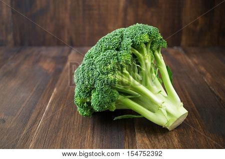 Raw broccoli on wooden table. Green vegetable horizontalselective focus