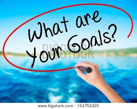 Woman Hand Writing What Are Your Goals?  With A Marker Over Transparent Board