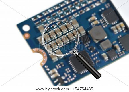 Clear image in magnifying glass against blurry close-up of a high speed M2 SSD storage drive isolated on white poster