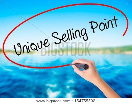 Woman Hand Writing Unique Selling Point With A Marker Over Transparent Board
