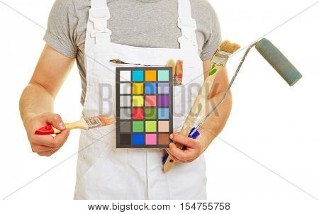 Painter showing wall color celection with his brush