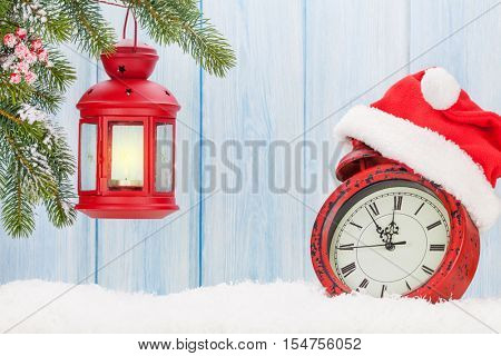 Christmas candle lantern and alarm clock with santa hat