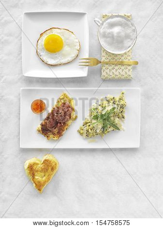 Fresh Continental Breakfast. Healthy Different Food. Scrambled Eggs, Salad, Cheese, Prosciutto, Coffee and Juice. Concept of Business or Vacation Breakfast. View from Above.