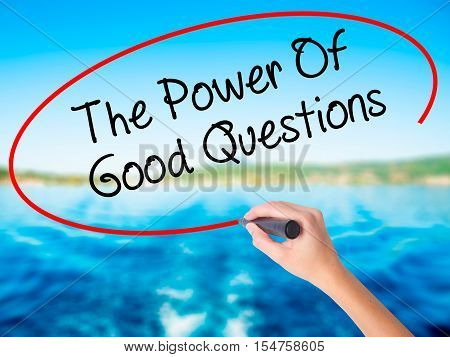 Woman Hand Writing The Power Of Good Questions With A Marker Over Transparent Board