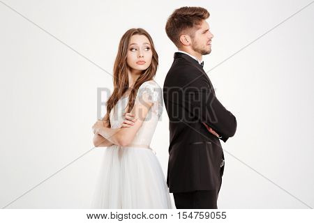 Irritated couple ignoring each other. white background