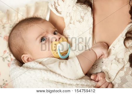 baby portrait in mother hand, happy maternity concept