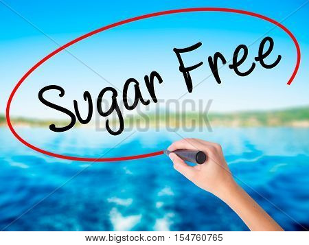 Woman Hand Writing Sugar Free With A Marker Over Transparent Board
