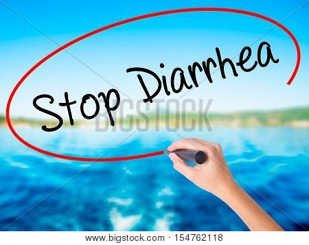 Woman Hand Writing Stop Diarrhea  With A Marker Over Transparent Board