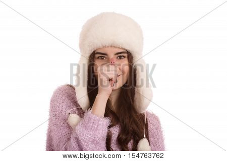 fun girl in winter hat making snout isolated on white background