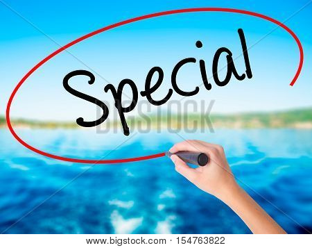Woman Hand Writing Special With A Marker Over Transparent Board