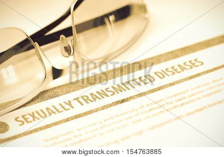 Sexually Transmitted Diseases - Printed Diagnosis with Blurred Text on Red Background with Eyeglasses. Medical Concept. 3D Rendering.