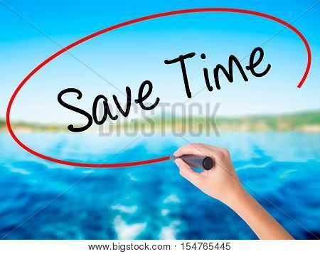 Woman Hand Writing Save Time With A Marker Over Transparent Board