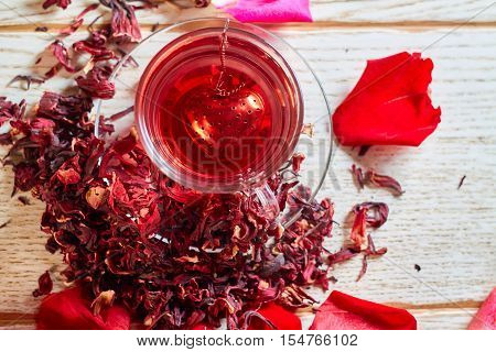 Red Hibiscus Tea In Glass Mug