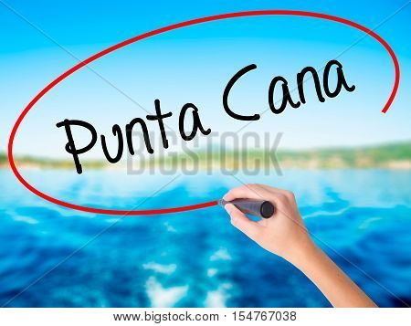 Woman Hand Writing Punta Cana With A Marker Over Transparent Board