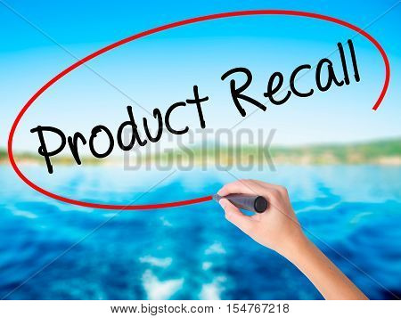 Woman Hand Writing Product Recall With A Marker Over Transparent Board