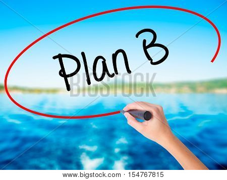 Woman Hand Writing Plan B With A Marker Over Transparent Board