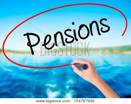 Woman Hand Writing Pensions With A Marker Over Transparent Board