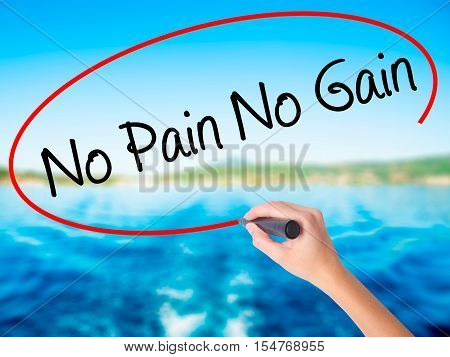 Woman Hand Writing No Pain No Gain With A Marker Over Transparent Board