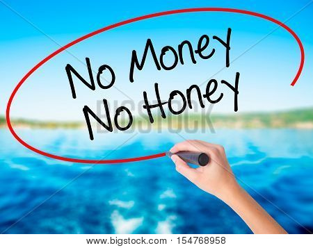 Woman Hand Writing No Money No Honey With A Marker Over Transparent Board.
