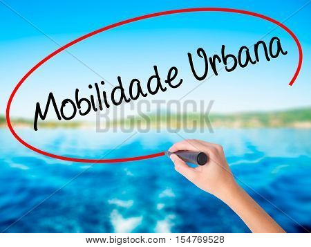 Woman Hand Writing Mobilidade Urbana (urban Mobility In Portuguese With A Marker Over Transparent Bo