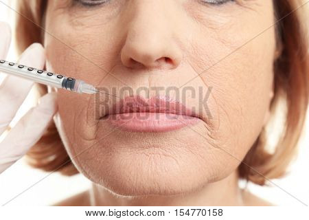Procedure of lips augmentation with hyaluronic acid injection