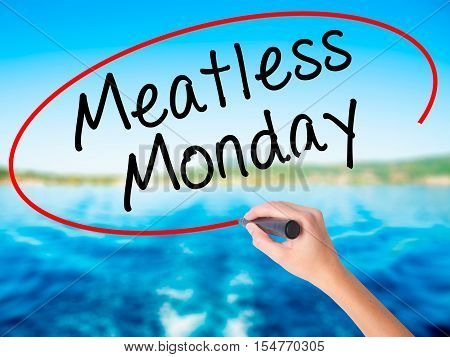 Woman Hand Writing Meatless Monday With A Marker Over Transparent Board