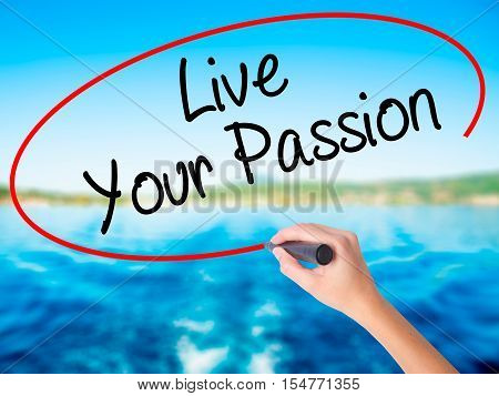 Woman Hand Writing  Live Your Passion With A Marker Over Transparent Board
